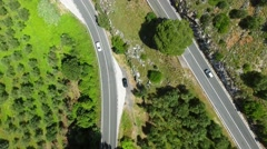 Aerial view of road across mountains - stock footage