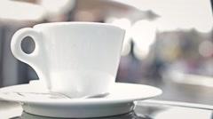 Hot Coffee Mug In Restaurant Terrace In Busy Street - stock footage