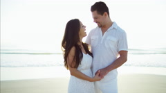 Portrait of beautiful Latin American couple enjoying togetherness on the beach Stock Footage