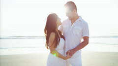 Loving Latin American couple enjoying time together on the beach outdoor Stock Footage
