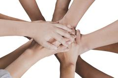 people put hand together  isolated on white background for use as teamwork, u - stock photo