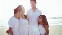 Portrait of happy Hispanic family enjoying Summer on the beach vacation Stock Footage