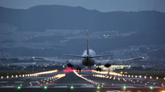 Big plane landing during the blue hour Stock Footage