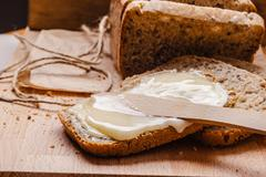 Still life fresh bread with butter and honey Stock Photos
