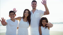 Portrait of happy Latin American family having fun on the beach vacation Stock Footage