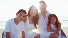 Portrait of happy Spanish family enjoying Summer on the beach vacation Stock Footage