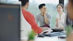 4K Portrait smiling office worker collaborating with coworkers & working at desk - stock footage