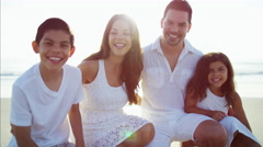 Portrait of smiling Hispanic parents and children enjoying Summer on the beach Arkistovideo