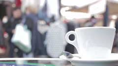 Coffee Mug On Terrace On a Crowded Street In Paris, France - stock footage