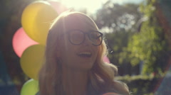 Nice girl smiles and flirts with someone in the sunny park. RAW video record Stock Footage