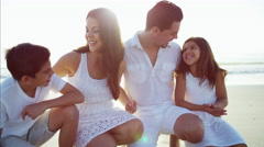 Portrait of happy Latin American family having fun on the beach holiday Stock Footage