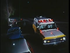 Emergency ambulance arriving at scene of accident, 1970s Stock Footage