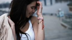 Young laughing adorable brunette woman touching her hair, smiling, looking away Stock Footage