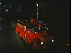 Fire truck arriving on scene of burning car, 1970s Stock Footage