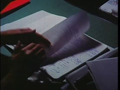Woman turning notebook pages at desk, 1970s Stock Footage