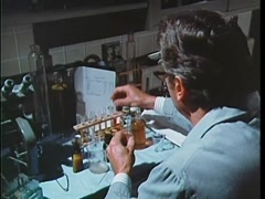 Scientist filling test tube with chemicals in laboratory, 1970s Stock Footage