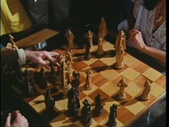 Man taking a white bishop with a black pawn during chess game, 1970s Stock Footage