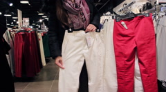 Girl Is Shopping For Breeches In A Department Store - stock footage
