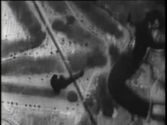 Aerial shot of male skydiver free falling from airplane, 1930s - stock footage