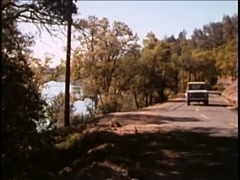 Jeep traveling on country road, 1970s Stock Footage