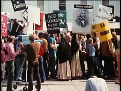 Demonstrators holding signs during protest, 1970s - stock footage