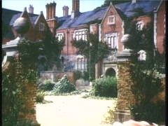Wide shot of couple arriving at estate in convertible, 1950s Stock Footage