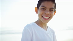 Portrait of smiling Spanish boy spending Summer vacation at a beach resort Stock Footage
