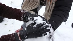 Hands Building Snowman Together Close Up Stock Footage