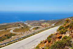 Curvy road near Chora Sfakion town on Crete, Greece Stock Photos