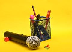 Microphone with paper holding pins and stationery box - Motivational Speaker Kuvituskuvat