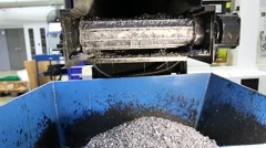 Chip conveyor moving steel chips from coolant tank to the scrap bin Stock Footage
