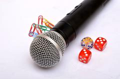 Microphone with paper holding pins and dice - Motivational Speaker Kuvituskuvat