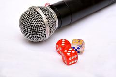 Microphone with dice - Motivational Speaker Stock Photos