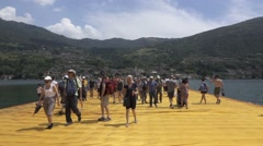 "Christo and Jeanne-Claude's ""Floating Piers"" - Crowd of Tourists Stock Footage"