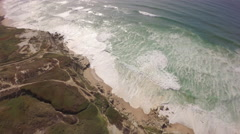 Aerial shot of ocean front cliffs in Praia de Santa Cruz - Portugal - stock footage