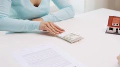 woman paying money to realtor and taking house key - stock footage