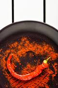 Red pepper with ground paprika. - stock photo