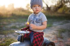 Toddler posing with toy race car Stock Photos