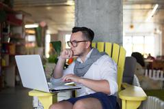 Trendy man working in startup office - stock photo