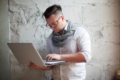 Man posing on workplace in startup office - stock photo
