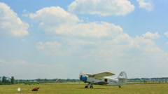 Light aircraft taxiing on the airfield Stock Footage