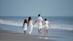 Spanish children spending leisure time with parents by ocean outdoors Stock Footage