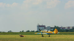Light aircraft is on the airfield Stock Footage