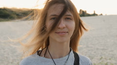 Portrait of indy girl on the beach. hair fluttering in the wind Stock Footage