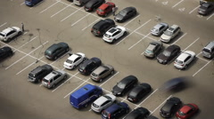 Cars are parked in the parking lot and leave the parking place. Timelaps - stock footage