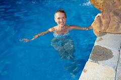 Woman in wimming pool. - stock photo
