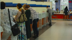 View of People Stand Near Counter of Public Service Officials. Financial Stock Footage