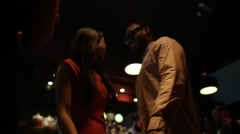 4K Low angle view of couple dancing together & having fun in nightclub Stock Footage