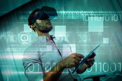 Blue technology design with binary code against businessman using an oculus Kuvituskuvat