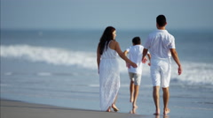 Young Hispanic parents and children having fun on beach vacation Stock Footage